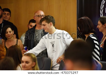 CLUJ-NAPOCA, ROMANIA - AUGUST 8, 2016: Dutch Dj, record producer and musician Martin Garrix signs autographs for fans at the press conference at Untold Festival