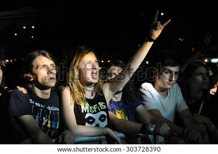 CLUJ NAPOCA, ROMANIA - AUGUST 2, 2015: Headbanging crowd during a rock concert at the Untold Festival - stock photo
