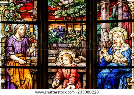 CLUJ NAPOCA, ROMANIA - AUGUST 21, 2014: Jesus Christ, Virgin Mary And Joseph Stained Glass Window Inside The Gothic Roman Catholic Church of Saint Michael Built In 1390. - stock photo