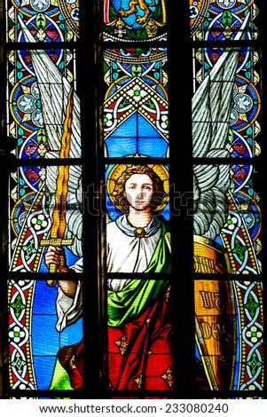 CLUJ NAPOCA, ROMANIA - AUGUST 21, 2014: Saint Michael Stained Glass Window Inside The Gothic Roman Catholic Church of Saint Michael Built In 1390. - stock photo