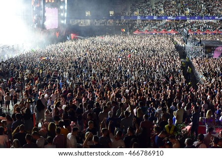 CLUJ-NAPOCA, ROMANIA - AUGUST 4, 2016: Stadium full with cheering crowd partying at a Faithless live concert during the Untold Festival