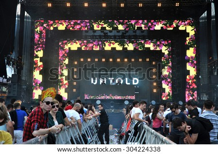 CLUJ NAPOCA, ROMANIA - AUGUST 2, 2015: Tehnicians setting the stage lights before a live concert at the Untold Festival  - stock photo