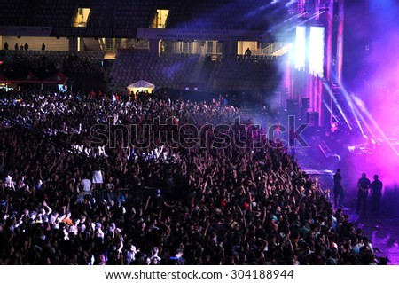 CLUJ NAPOCA, ROMANIA - JULY 31, 2015: Crowd of cheerful young people having fun during a Subcarpati live concert at Untold Festival