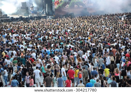 CLUJ NAPOCA, ROMANIA - JULY 30, 2015: Crowd of cheerful young people having fun  during a Tom Odell live concert at Untold Festival  - stock photo