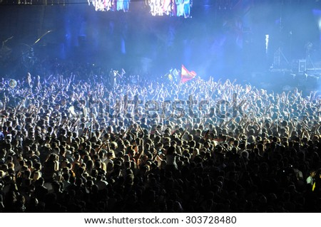 CLUJ NAPOCA, ROMANIA - JULY 31, 2015: Crowd of partying people dancing during a Casette live concert at the Untold Festival in the European Youth Capital city of Cluj Napoca - stock photo