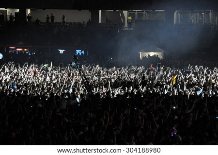 CLUJ NAPOCA, ROMANIA - JULY 31, 2015: Crowd of partying people dancing during a Casette live concert at the Untold Festival in the European Youth Capital city of Cluj Napoca