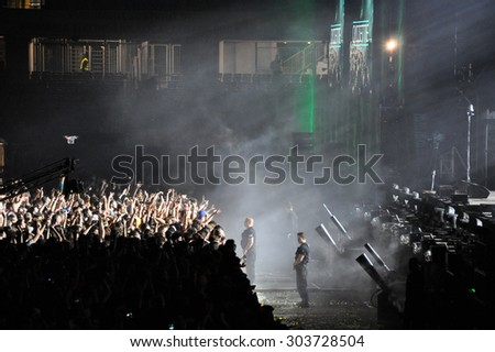 CLUJ NAPOCA, ROMANIA- JULY 31, 2015: Crowd of partying people dancing during a Casette live concert at the Untold Festival in the European Youth Capital city of Cluj Napoca - stock photo