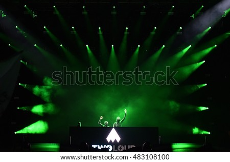 CLUJ-NAPOCA, ROMANIA - JULY 6, 2016: Disc jockey Twoloud mixing live on the stage in the front of crowd of people during the Untold Festival