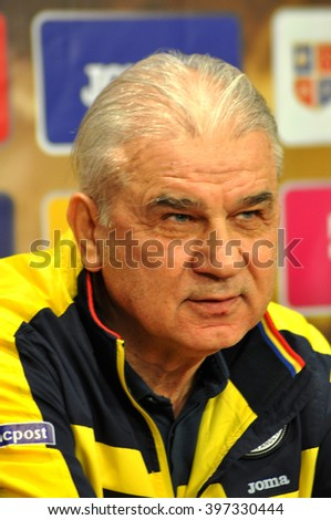 CLUJ-NAPOCA, ROMANIA - MARCH 26, 2016: Coach of the Romanian National Football Team, Mr. Anghel Iordanescu speaks during a press conference before the match against Spain - stock photo