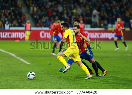 CLUJ-NAPOCA, ROMANIA - MARCH 27, 2016: Romanian National Team football player Nicolae Stanciu (yellow) in action during a friendly match against Spain before Euro 2016 - stock photo
