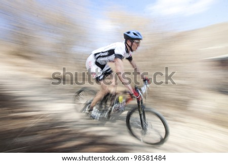 """CLUJ-NAPOCA, ROMANIA - MARCH 24: Unidentified competitor during the Clujul Pedaleaza mountain bike competition, 1st stage """"Napolact"""" on March 24, 2012 in Cluj-Napoca, Romania. - stock photo"""