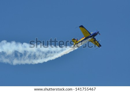 CLUJ NAPOCA, ROMANIA - MAY 18: A group of airplane, aircraft in flight smoke color at the Romanian Military Parade on May 18, 2013 in Cluj Napoca, Romania