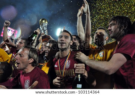CLUJ NAPOCA, ROMANIA  MAY 20: FC CFR Cluj players celebrating the new league title and the victory against FC Steaua Bucharest, final score 1:1 on MAY 20, 2012 in Cluj N, Romania