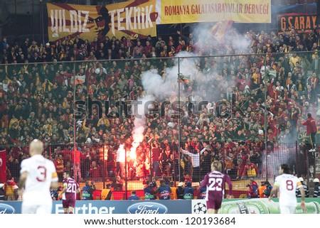 CLUJ-NAPOCA, ROMANIA - NOVEMBER 7: Galatasaray fans after scoring a goal, UEFA Champions League, CFR 1907 Cluj vs Galatasaray,  on 7 Nov., 2012 in Cluj-Napoca, Romania - stock photo