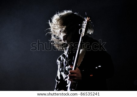 CLUJ NAPOCA, ROMANIA – OCTOBER 8: Teofil Boar guitarist from Pacifica rock band performs live at Cluj Arena Grand Opening concert on October 8, 2011 in Cluj-Napoca, Romania - stock photo