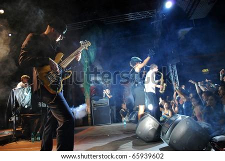 CLUJ NAPOCA, ROMANIA - SEPT. 27: Michael Wittner, the Parov Stelar's band guitarist performs a solo, live at Parov Stelar Concert, on September 27, 2009 in Cluj-Napoca, Romania - stock photo