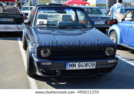 CLUJ-NAPOCA, ROMANIA - SEPTEMBER 24, 2016: Volkswagen golf cabrio 1800 classic convertible car in the parking lot