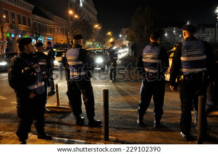 CLUJ, ROMANIA - NOVEMBER 8: Group of policemen try to restabilize the order during the street protest in Cluj against the corrupt Romanian Government. On Nov 8, 2014 in Cluj, Romania - stock photo