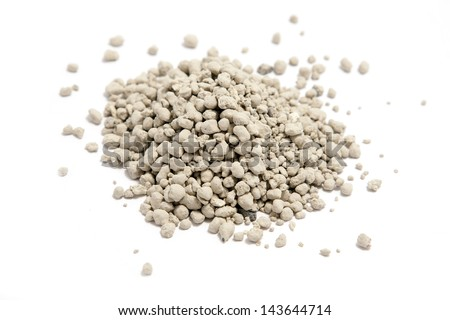 clumping clay cat litter on white - stock photo