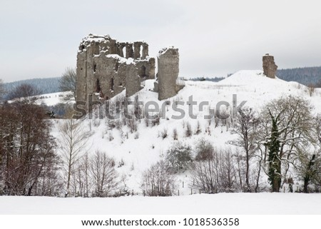CLUN, UK - DECEMBER 12: The medieval castle of Clun stands on the hillside just outside the similarly named village after a heavy snowfall on December 12, 2017 in Clun.