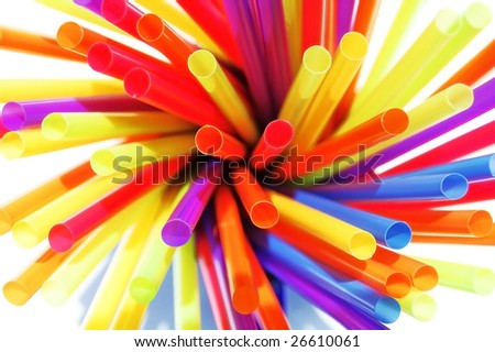 Cluster of colorful straws in a cup