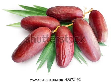 cluster of dates with leaves on a white background - stock photo