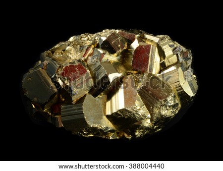 Cluster of pyrite crystals,  isolated on black background