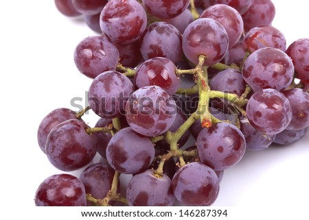 Cluster of red grapes isolated on a white background