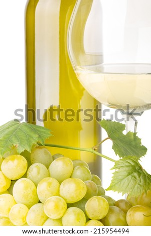 Cluster of white grapes with grapevine, glass of wine and bottle on white background - stock photo