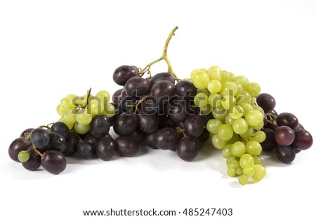 Clusters of green and black lie grapes on a white background.