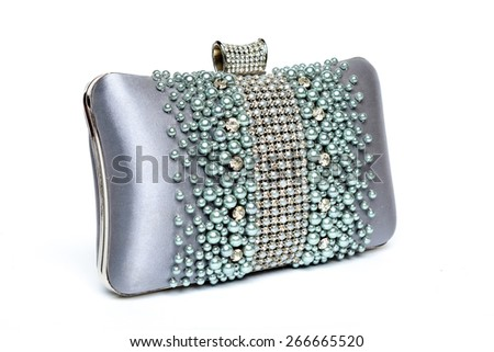 Clutch decorated with beads and diamonds on a white background - stock photo