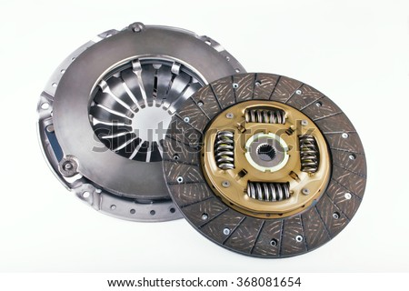 Clutch disc, clutch cover for car on a white background. Spare parts for shop, aftermarket, OEM. New spare parts for shop. Transmission auto spare parts for car. Isolated auto spare parts. - stock photo