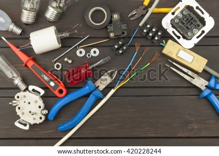 Clutter on the workbench. Tools, electronics repairman. Repair of household electrical equipment. Sales of electronics components. Advertising on servicemen. - stock photo