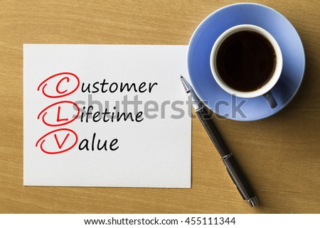 CLV Customer Lifetime Value - handwriting on paper with cup of coffee and pen, acronym business concept