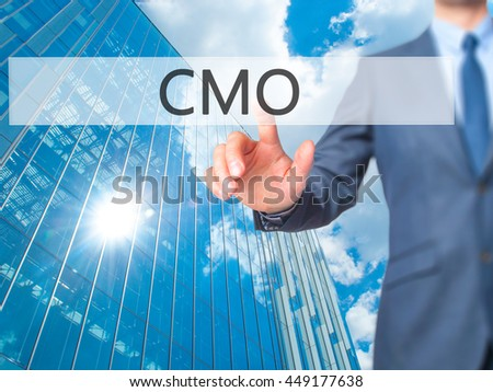 CMO - Businessman click on virtual touchscreen. Business and IT concept. Stock Photo