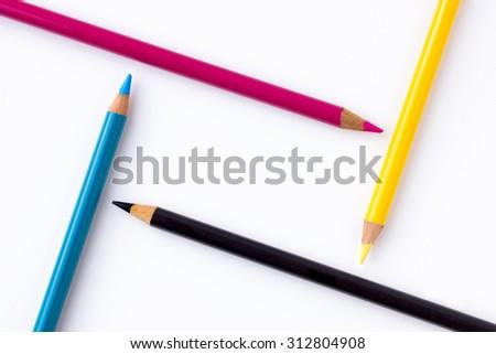 CMYK - Colored pencils in cyan, magenta, yellow & black - stock photo