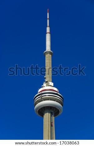 CN Tower against bright blue sky, Toronto, Canada - stock photo