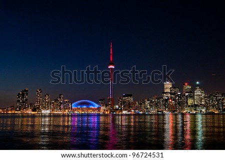 CN Tower Toronto Buildings at night - stock photo