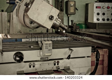 CNC drilling and milling in a workshop - colorized photo