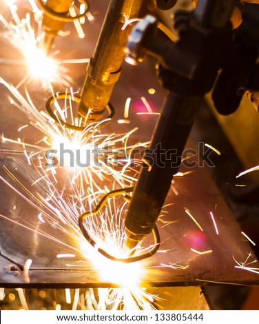 CNC LPG cutting with sparks close up - stock photo