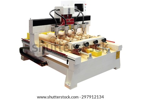 CNC milling machine making 4 wooden copies simultaneosly, isolated on white - stock photo