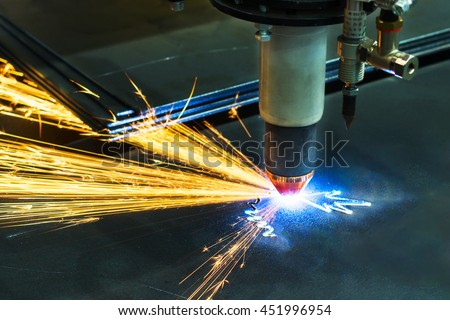 CNC plasma cutting machine during operation. Processing of the steel sheet. - stock photo