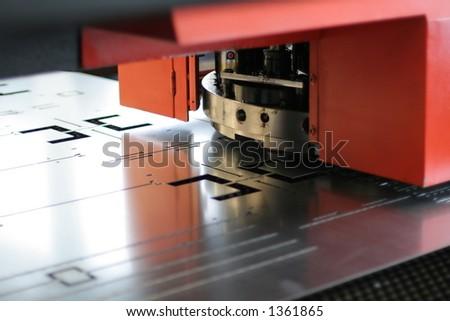 CNC sheet metal stamping or punching machinery - stock photo