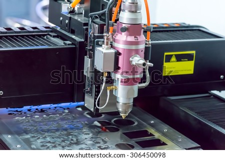 CNC wire cut machine cutting metal  - stock photo