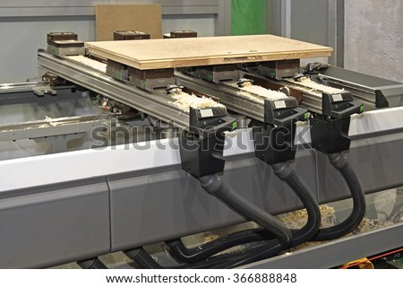 CNC Woodworking Machine in Wood Work Shop - stock photo