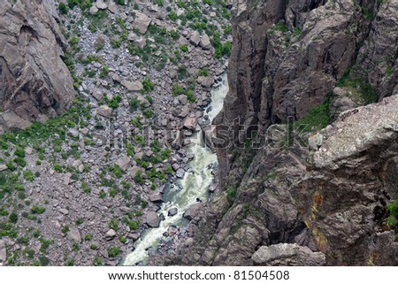 CO-Black Canyon of the Gunnison National Park-Looking over the 2,000 foot gorge into the Gunnison River is quite awesome. - stock photo