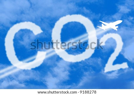 CO2 symbol against the sky with a plane passing through the clouds.