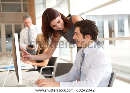 Co-workers in business training - stock photo