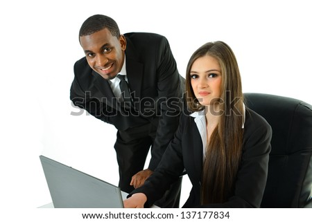 Co-workers working together as a team - stock photo