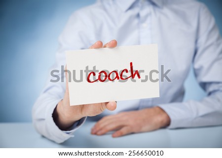 Coach advertisement concept. Man show card with text coach.  - stock photo